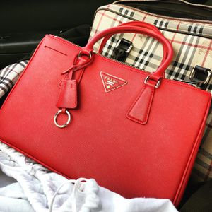 Prada Medium Red Lux Executive Double Zip Purse for Sale in St. Louis, MO
