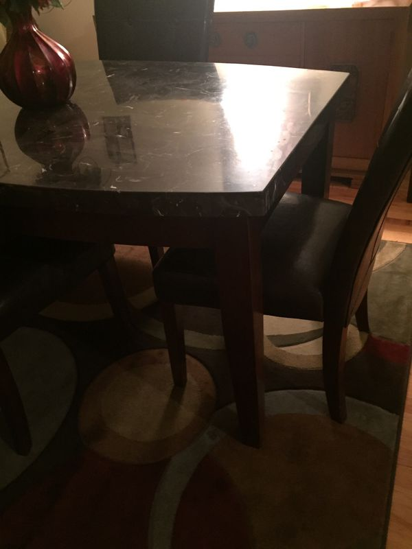 real granito marble table and lether chairs