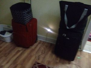 2 large suitcases. One is black one is red Ralph Lauren. Both in excelent cond for Sale in New Roads, LA