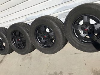 "4 Jeep Wrangler 17"" Stock Black Wheels OEM Rims Goodyear Fortera 245/70R17 Tires At 40% Tread Balanced In Good Condition $325 In Ontario 91762 for Sale in Chino,  CA"