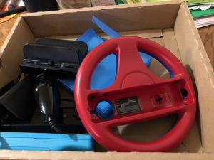 Nintendo Wii U Mario Kart deluxe edition with steering wheel with t games 500 for Sale in San Antonio, TX