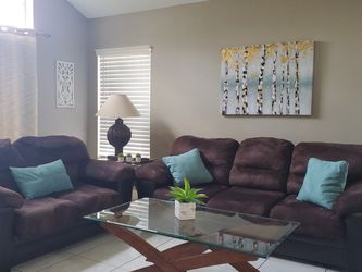 Brown Sofa, Loveseat and Coffee Table and 1 End Table. for Sale in Hollywood,  FL