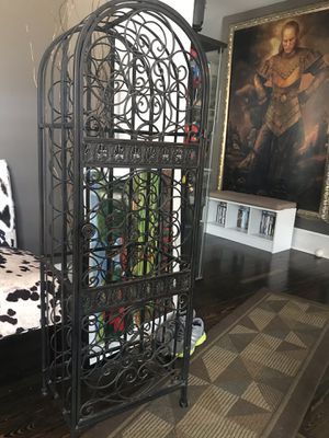Wrought iron wine rack with locking door for Sale in Beverly, NJ