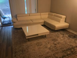 4 pc set white leather section two area rugs and coffee table for Sale in Delray Beach, FL