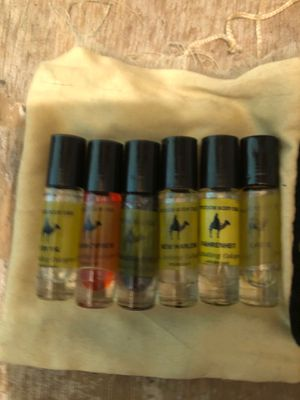 Body oil man and girl and make up brushes for Sale in Chesterfield, VA