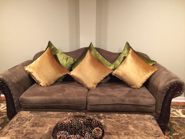 Living room sofas with decorative pillows and matching curtains