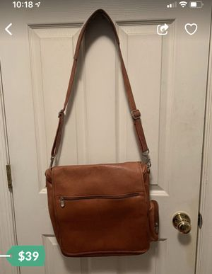 Mens genuine leather messenger bag. Multiple pockets inside and out. 12 inches wide, 14 tall without the hanger and 32 inches including the hanger. 5 for Sale in Centreville, VA