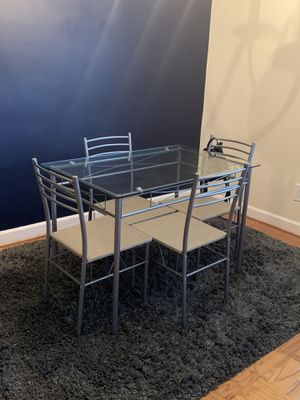 Glass dining table and chairs for Sale in Arlington, VA