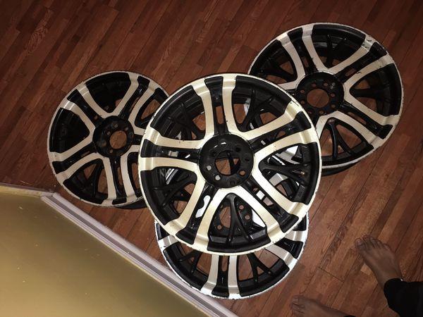four used black and chrome deep dish rims