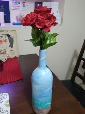 Pretty beach bottle with Roses. Must see for Sale in Palmetto, FL