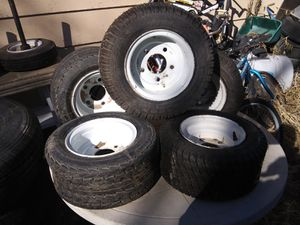 Mini tractor tires 7 total some with is Axel for Sale in Pueblo, CO