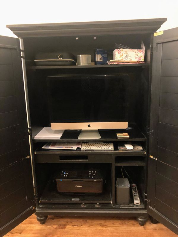 Desk Inside Black Armoire & Pottery Barn Bankers Chair