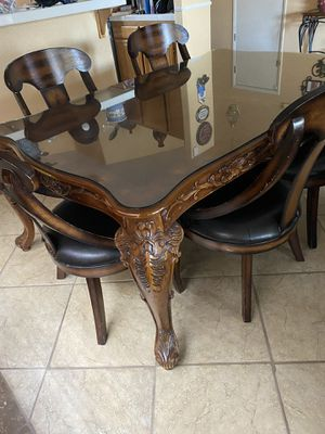 Wood dining table with protective glass 5 chairs-Pick Up for Sale in North Las Vegas, NV