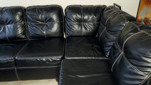 Black sectional couch with sleeper in good condition
