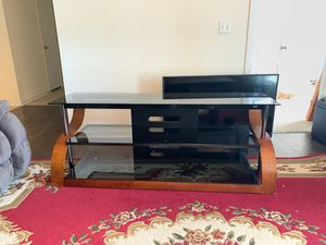 2 TV Stands for sales!! Not TV's stands only!!! One holds a 60 inch and the other a 50 inch TV!! for Sale in Charlotte, NC