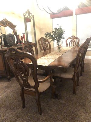 Dinning Room Table with 2 leaves, 8 chairs and beautiful buffet. Like new, no scratches or stains. Table seats 8 comfortably and we have had up to 12 for Sale in Fresno, CA