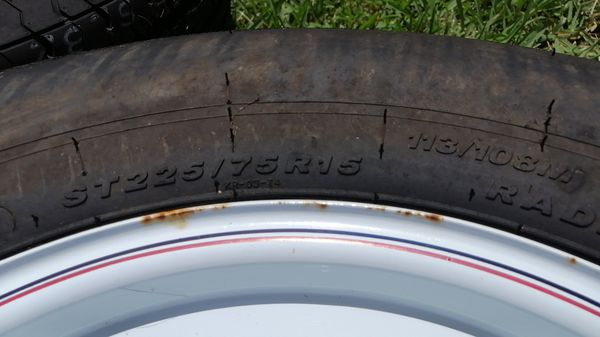 Three 225/75/15 D trailer tires with 6 lug wheels