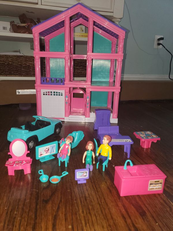 Doll house with furniture and family, working garage door