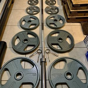 300 lb Complete Olympic Weight Set with Chrome Bar and Cast Iron Grip Plates. Brand New, In Boxes for Sale in Miami, FL