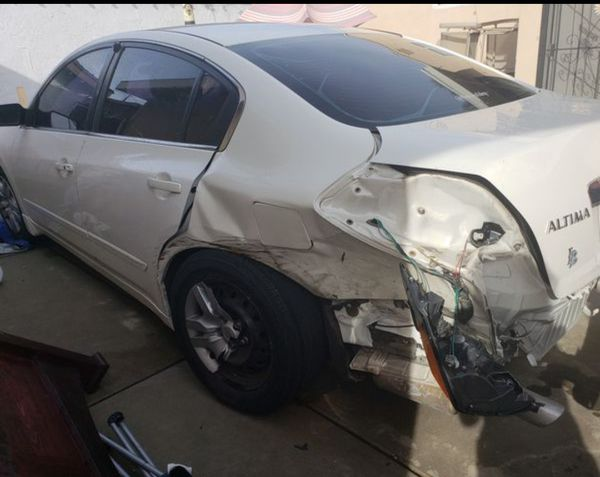 white 2011 Nissan Altima for parts