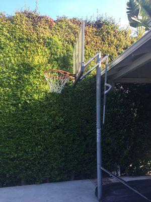 Lifetime shatterproof basketball hoop adjusts to 10 feet. Normal wear for Sale in Los Angeles, CA