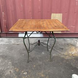 Outdoor wooden patio Table With Ornate Metal Base for Sale in Long Beach,  CA