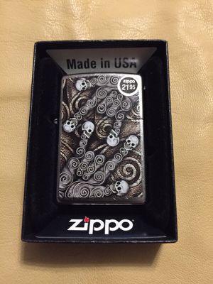 Zippo lighter skull scroll hand new for Sale in West Valley City, UT