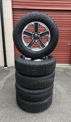 "BRAND NEW 18"" OEM Jeep Wheels with Bridgestone Tires 5x5 for Sale in Mukilteo, WA"