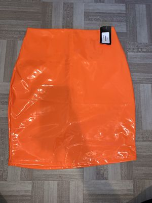 Orange (size small) leather mini skirt with tags for Sale in Sharon Hill, PA
