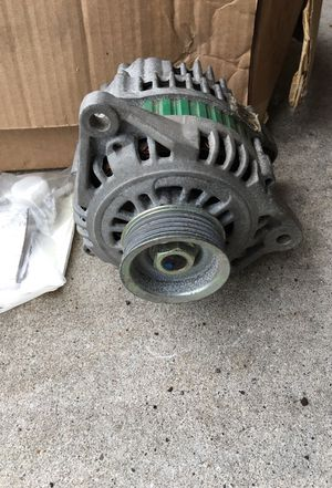 Alternator and valve assy parts for infinity 1999 QX for Sale in Holland, MI