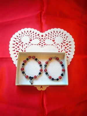 2 pc red / black bracelets with hearts for Sale in Colton, CA