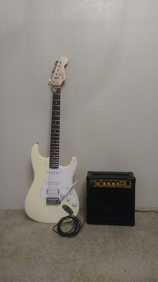 Squire bullet strat guitar by Fender with amp.