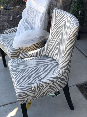 Brand new zebra pattern studded set of accent chairs. Retails for over $420 for Sale in Fowler, CA