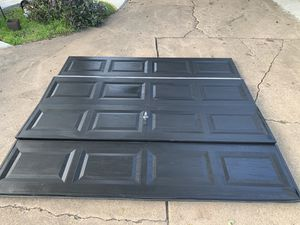Used single car garage doors I have (2) painted black with all hardware and rails for Sale in DeSoto, TX