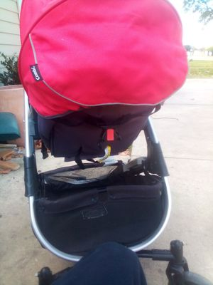 Combi baby stroller fairly new also converts into car seat the stroller has no tears or stains for Sale in Texas City, TX