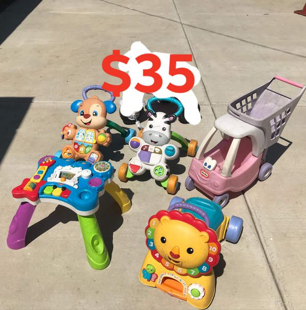 Kids toys walker push car FIRM PRICE NO DELIVERY CASH OR TRADE FOR BABY FORMULA