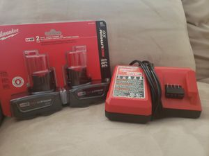 Milwaukee M12 and M18 Charger and Two Milwaukee M12 Red Lithium XC Batteries for Sale in Downey, CA