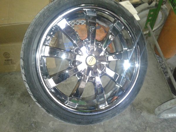 265/40/22 Chrome rims and tires set of four
