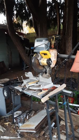 Dewalt 10 in. Chop saw with a wheeled cutting adjustable table for Sale in Eugene, OR
