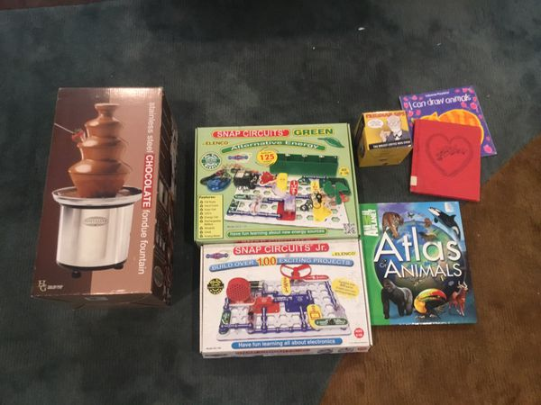Chocolate fountain (NEW), two snap circuits sets, one new mug, three books. FREE