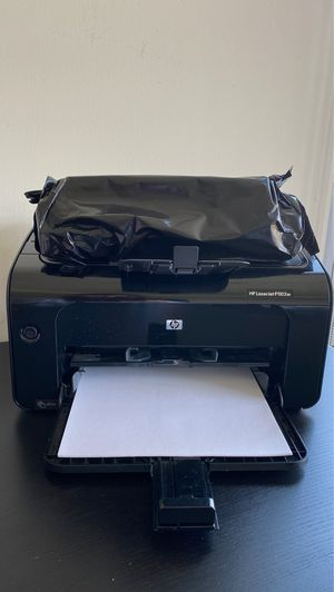 HP laser printer + new ink + Ink replacement + paper for Sale in Cleveland, OH