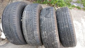 Set of 4 Michelin P205/65R15 All Season tires + rims for Sale in Chesterfield, VA