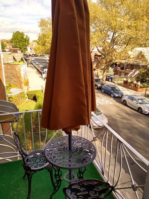 New Small patio table with 2 chairs umbrella. for Sale in Brooklyn, NY