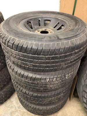 Set of 4 wheels and tires 5x4.5 ford/ Jeep for Sale in Beaumont, CA