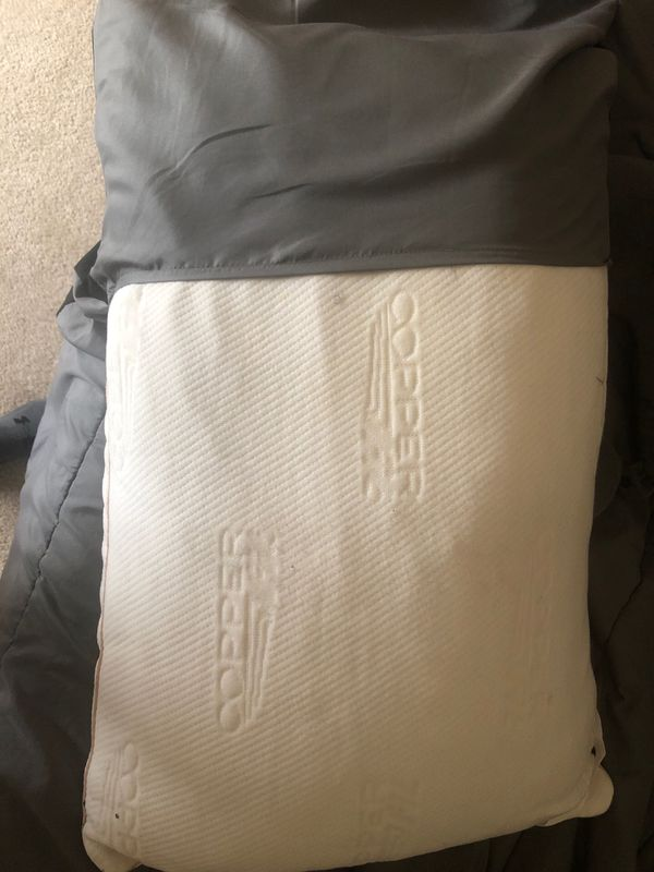 2 brand new copper fit pillows asking for $35 for both only used as shams never slept on