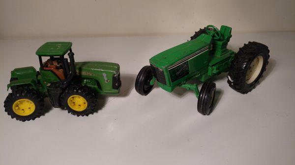 Set of 2 John Deere vintage articulating tractors