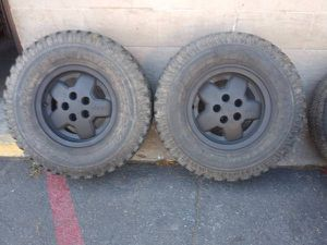 Two black alloy rims and 31 inch tires 5 lug Dodge, Ford, Jeep, Toyota for Sale in Montebello, CA