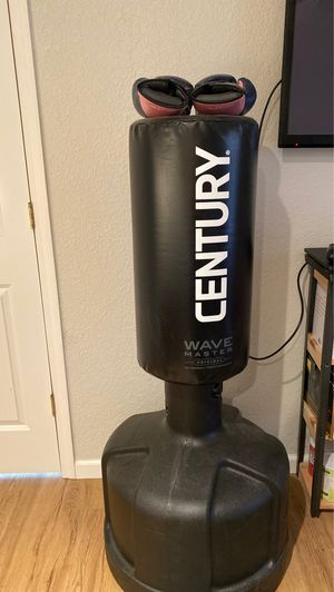 Century wave master freestanding boxing bag and women's boxing glove for Sale in Traverse City, MI