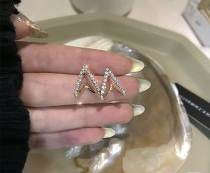Diamond triangle stud earrings for Sale in Rowland Heights, CA