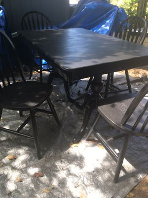 Beautiful black two pedestal all wooden table... for Sale in Tacoma, WA